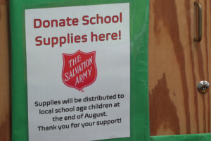 Salvation Army donating backpacks and school supplies to the community