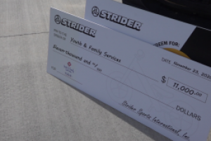 Youth and Family Services receives cash donation, new bikes from Strider