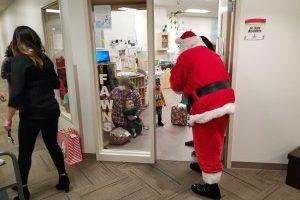 Santa, Ellsworth airmen bring presents, cheer to YFS