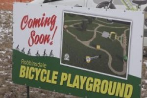 Strider Bikes makes sizeable donation for one-of-a-kind kids' bicycle playground