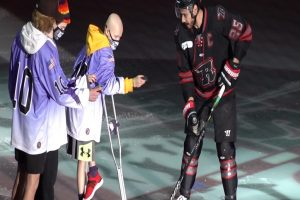 BIG TIME RUSH: 11-year-old cancer patient drops puck at Rush game