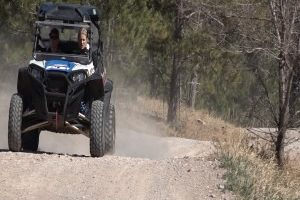 Off-road vehicle riders practice safety while strolling through trails