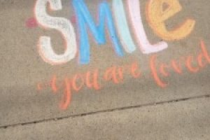 """Messages of hope and positivity adorn local sidewalks for """"Chalk Your Walk Day"""""""