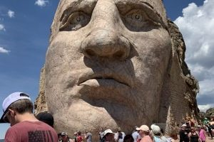 Crowds brave the heat to stand on top of Crazy Horse Memorial